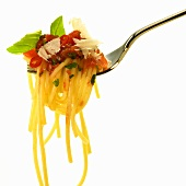 Spaghetti with tomato and chili sauce and Parmesan on fork