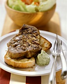 Barbecued pork neck steaks, marinated in beer & mustard