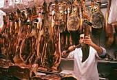 Butcher cutting ham (Paleta Iberica Bellota)