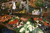 Fresh vegetables and herbs on a market stall