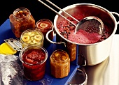 Five jam jars, jam pan and skimmer