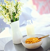 Breakfast still life with cornflakes and milk bottle