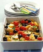 Cod with potatoes, cherry tomatoes and black olives