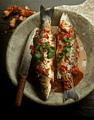 Roast trout in chili & tamarind stock with coriander