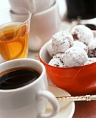 Chocolate truffles in a bowl, cup of coffee and sweet wine