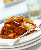 Pan-cooked sausages & vegetables, tomato sauce & potato cakes