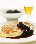 Sweet pancakes with blueberry sauce