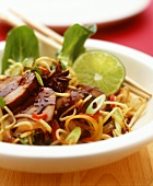 Chinese style roast pork with noodles, chili