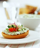Toasted roll with herb soft cheese and vegetable garnish