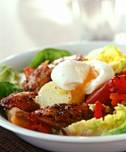 Salad with smoked fish and poached egg