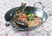 Whole trout with diced bacon in white wine & cream sauce