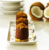 Mousse au chocolat on sweet pastry base with grated coconut
