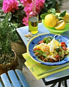 Colourful courgette salad with strips of chicken and tomatoes
