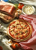 Ham and mushroom pizza with ingredients