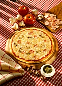 Ham and mushroom pizza with a lot of cheese; ingredients