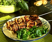 Duck kebab with sesame and pieces of ginger root