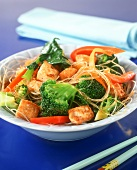 Fried vegetables from the wok with glass noodles and tofu