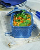 Jellied poultry with vegetables in a blue terrine