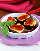 Caramelised fig halves in red wine sauce