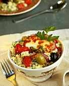 Couscous with Halloumi cheese, tomatoes, olives and capers