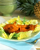 Fried bacon and pineapple on lettuce hearts