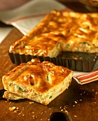 Piece of pie with potatoes and smoked salmon