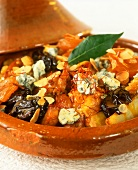 Tajine with rabbit legs, potatoes and blue cheese