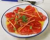 Tuna carpaccio in chili oil with strips of carrot