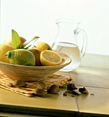 Mediterranean still life with lemons in a bowl, almonds
