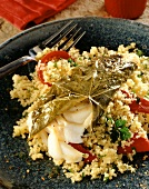 Cod in vine leaf on bulgur wheat
