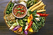 Pak djim naam prik (vegetable platter with dip, Thailand)