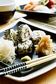 California maki (surimi and avocado, coated in sesame)