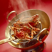 Cooking crabs in wok