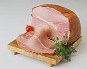 Cooked ham (Kochschinken) on wooden board