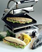 Panini with smoked salmon on a panini grill (Italy)