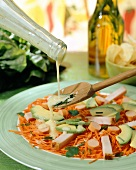 Raw carrot salad with avocado and cooked ham