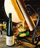 Traditional raclette with bottle of French white wine