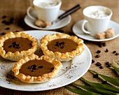 Small coffee cream tartlets in puff pastry
