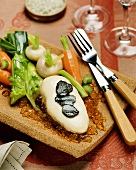 Cheese-coated chicken breast with truffles on aspic