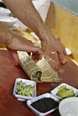 Rolling sushi using a bamboo mat