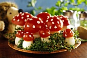 'Fly agarics' made from boiled eggs & tomatoes on bed of cress
