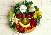 Food collage: face made from vegetables, fruit and spices