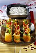 Colourful sushi-style salmon snacks, yoghurt dip behind