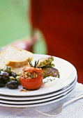 Tomatoes stuffed with tuna paste, courgette cakes, olives