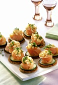 Smoked salmon nests on rounds of toast