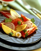 Tomato and onion salad with pieces of mango