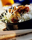 Chicken with deep-fried rice noodles