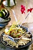 Vegetable salad with soya sprouts on enokitake mushrooms