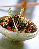Pork with vegetables, soba noodles and sesame