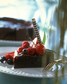 A piece of chocolate cake with berries